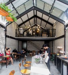 Image 1 of 29 from gallery of Brewman Coffee Concept / 85 Design. Photograph by To Huu Dung Cafe Shop Design, Coffee Shop Interior Design, Coffee Design, Industrial Coffee Shop, Industrial Cafe, Outdoor Restaurant Patio, Outdoor Cafe, Cafeteria Industrial, Glass House Garden
