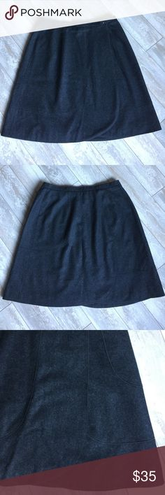 """Harve Bernard Wool-blend Wrap-around Skirt.17293 Harve Bernard  55% wool, 45% viscose, A-line skirt is charcoal in color. Waistband is 1"""" x 34"""" with 9.5"""" panel overlap for asymetric left front closure (2 buttons 9"""" apart). The panel overlap is rounded at hem. Hip measurement is approximately 48"""" around. Skirt is 24"""" in length; 56"""" in circumference at hem. Fully lined in 100% black polyester. In excellent condition. Worn twice. Harve Benard Skirts A-Line or Full"""