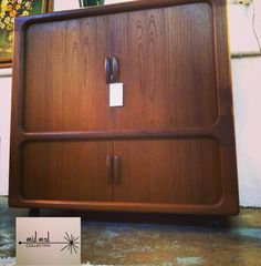 Dyrlund teak cabinet with tambour doors closed. Available now at Mid Mod Collective. Email midmodcollective@gmail.com for more info. SOLD!