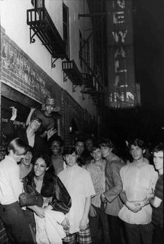 In the early hours of June 28, 1969, the crowd that lingered outside the club was still 500 strong, initially festive but increasingly angry as the raid progressed. The turning point came when the crowd saw the police slam a lesbian, who was struggling to resist arrest, against a police car.nPhoto: Fred W. McDarrah/Getty Images.