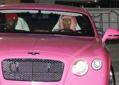 Nicki Minaj just like a barbie in her pink car!  ; )