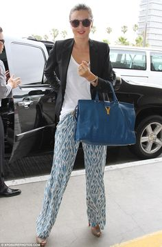 Bohemian: Supermodel Miranda Kerr wore a pair of trousers very reminiscent of pajamas as she arrived at LAX airport today