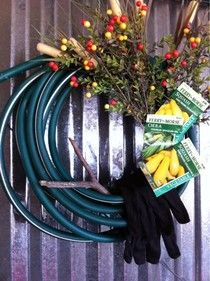 "This is a wreath made from a water hose.  The moral of the story: ""wreaths are too expensive"" is no excuse for my bare front door!"