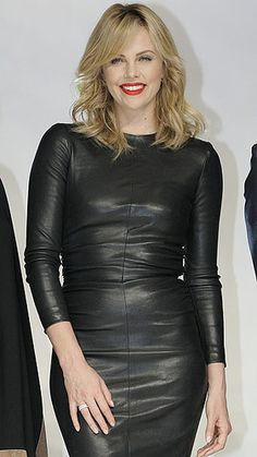 Charlize Theron in black leather dress.