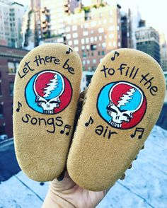 Let there be songs to fill the air. Because being Grateful runs in the family. Heritage, handpainted baby moccs youll treasure forever. Custom baby moccasins are one-of-a-kind, hand-painted by me! I can paint the steal your face design and quote on the tops, or on the soles of the