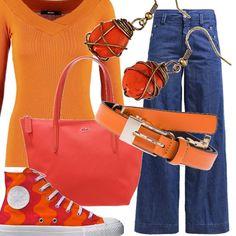 Bello anche in autunno l'arancio, qui proposto in una casacca aderente indossata sui jeans a zampa. Rigorosamente arancio gli accessori: le Converse in camouflage arancione, la cintura, la borsa sportiva e gli orecchini.