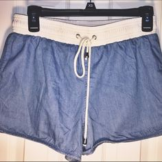 Color: Light denim/Cream. Never worn. Only tried on. Loose fitting. Size small. Adjustable waist