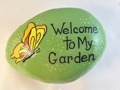 Hand-painted on River Rock. A whimsical rock for your garden, potted plant or a paper weight! This rock is painted Green with a splash of little yellow dots and a pretty yellow butterfly with the saying: Welcome To My Garden. It is sprayed with glossy spray. The back is not painted. Size: