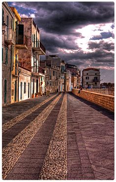 Alghero, Sardinia   Our weekend town while we lived in Italy... a couples hours drive a world away...