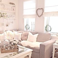 Cute corner sofa with lots of cushions. I love the natural light in this room, too.