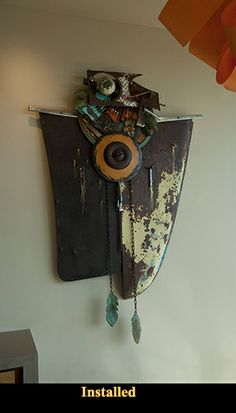 wall art, created with old rusted car hood and other found parts. #art #upcycled #recycled