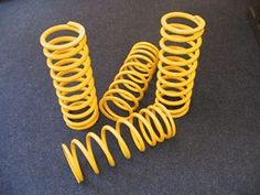 Land Rover Defender Front Coil Springs by Paddock. Land Rover Defender, Off Road Suspension, Jeeps, Time Travel, Colouring, Yellow, Jeep, Landrover Defender