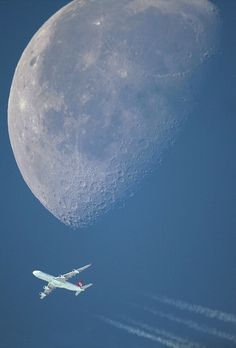 Telephoto (1000 mm lens ) zoomed in to see the commercial jet and then massively magnifies the moon too