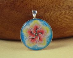 Red and Yellow Flower on a Blue Background Resin Pendant £6.00