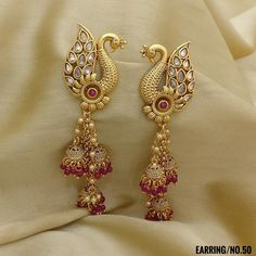 Peacock with Jhumki Style Earrings. Peacock with Jhumki Style Earrings. Rama Creations Manufacturer & Wholesalers of Artificial Fashion Jewellery in India. Indian Jewelry Earrings, Gold Jhumka Earrings, Jewelry Design Earrings, Gold Earrings Designs, Gold Jewellery Design, Bridal Jewelry, Gold Jewelry, Jewellery Box, Antique Earrings
