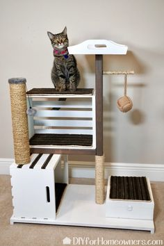 DIY Cat Tower - Mother Daughter Projects with built in storage for cat toys. Animal Projects, Diy Projects, Diy Jouet Pour Chat, Diy Cat Tower, Homemade Cat Tower, Cat House Diy, Cat Towers, Cat Enclosure, Pet Furniture