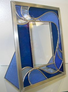Handmade Stained Glass Picture Frame br br Translucent Navy Blue Medium Blue and Pale Blue Glass br Zinc frame br Picture Frame is approx w x h br Clear smooth Stained Glass Frames, Stained Glass Angel, Stained Glass Designs, Stained Glass Projects, Stained Glass Patterns, Leaded Glass, Mirror Mosaic, Mosaic Glass, Fused Glass