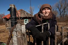 Kharytina Descha, 92, is one of the several hundred elderly people who have returned to their village homes inside the Exclusion Zone of the Chernobyl disaster. Although surrounded by devastation and isolation, she prefers to die on her own soil. Teremtsy, Ukraine, 2011