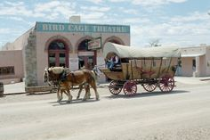 Tombstone, Arizona  ~  The Bird Cage Theatre was built in 1881   and was there during all the real events that took place here. The covered wagon dates from the 1830s and 1840s.