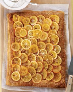 Meyer Lemon Pastry   Martha Stewart Living - This tart looks incredible, and is easy to make, too. Thin slices of Meyer lemons are poached in simple syrup to make sweet candied circles, and then arranged on store-bought puff pastry.