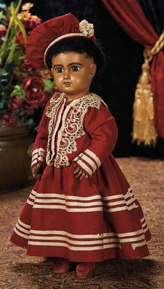 The Lifelong Collection of Berta Leon Hackney: 228 French Brown-Complexioned Bisque Bebe by Jumeau with Original Costume