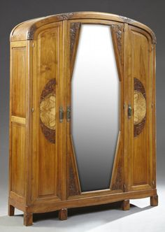 French Art Deco Carved Walnut Armoire, c. 1940, the : Lot 744A