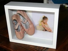 Shadow box for first ballet shoes. Also cute for other items such as baseball mitts, etc