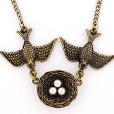 Beautiful Vintage Feel Gold-tone Swallow Couple and Their Nest Necklace by JuliesJewelryStore on Etsy https://www.etsy.com/listing/90104705/beautiful-vintage-feel-gold-tone-swallow
