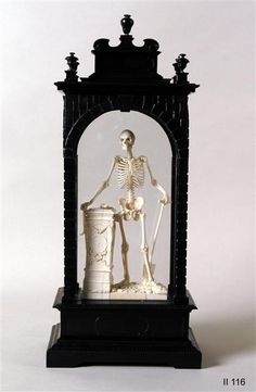 An ivory figure of a skeleton, by Christof Angermair, 1632, personifies death and serves as a memento mori; the skeleton holds a spade, a symbolic reference to digging a grave; click through for more (in German). (Staatliche Kunstsammlungen Dresden)
