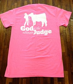 """God is the Ultimate Judge"" Stock Show Apparel, show cattle graphic on back. Neon Pink. $16.99, buy here: http://www.stockshowsweethearts.com/cattle-god-is-the-ultimate-judge-shirt/"