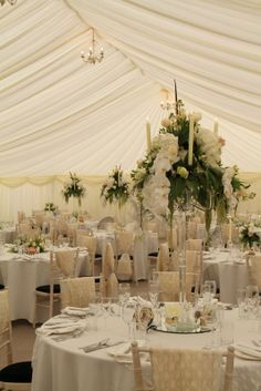 Our Crystal Candelabras created volume and filled the upper spaces, each one dripping in Orchids, Roses, Peonies, Stocks, White Almond Blossom, White Freesia, Hydrangeas, trailing Amaranthus, Variegated Aralia and Pheasant and Partridge Feathers