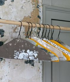 Cloth covered wire hangers, maybe spray paint them too,