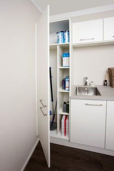 Practical space for the storage of cleaning equipment Hamptons House, The Hamptons, Utility Cabinets, Household Organization, Cleaning Equipment, Bathroom Medicine Cabinet, Cleaning Hacks, Laundry Room, Bookcase