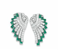 A PAIR OF ART DECO DIAMOND AND EMERALD CLIP BROOCHES, BY HENNELL  Each designed as a circular and baguette-cut diamond scalloped plaque, extending a graduated baguette-cut diamond fringe, bordered by rectangular and square-cut emeralds, mounted in platinum and white gold, circa 1930 Each signed Hennell (2)