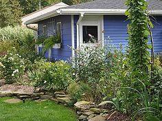 Garden beds by garage; 2966 Indian Trl, Pinckney, MI 48169