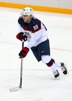 Patrick Kane #88 of United States handles the puck against Slovakia during the Men's Ice Hockey Preliminary Round Group A game.