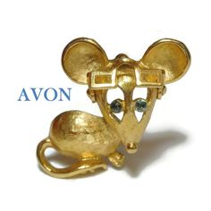 """Use code SOCIAL15 for 15% off all purchases over $15, plus FREE shipping on most jewelry! Avon mouse brooch, gold with blue rhinestone eye, moveable articulated glasses, glasses move up and down, scatter pin.  This figural pin measures 1 1/4"""" (3.2 cm) long. The ... #etsygifts #vintage #vjse2 #jewelry #gift"""