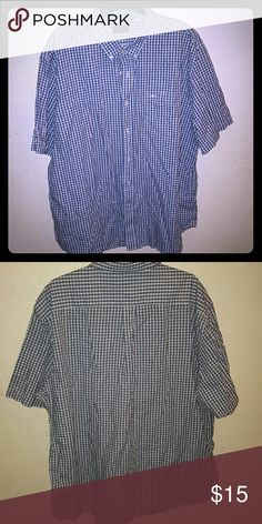 Dockers button down shirt Size XXL Item is great condition did not fit new without tags the color is blue or navy blue with white checkered 55% cotton 45% polyester Dockers Shirts Casual Button Down Shirts