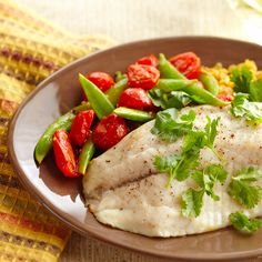 Baked tilapia fillets are served alongside curry-flavored lentils pea pods and cherry tomatoes in this colorful and healthy dinner recipe. With a few substitutions you can turn this dish into a sandwich or a bowl (see recipe variations below). Tilapia Recipes, Fish Recipes, Healthy Recipes, Scd Recipes, Seafood Recipes, Easy Diabetic Meals, Diabetic Recipes, Diabetic Foods, Baked Tilapia Fillets