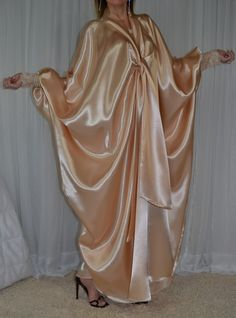 The feeling of satin sliding over you skin is one of the greatest sensations for every sissy. This kaftan will provide plenty of the sensation with every move and will make sissies of all shapes shine