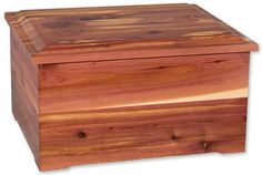 - A masterfully crafted cedar wood companion cremation urn. Contains a removable divider for ash placement. - Each cedar urn has a distinct, unique grain pattern. - The urn is loaded from the bottom u