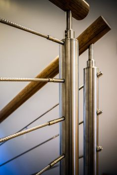 A modern railing can increase the visual appeal of your stairs and potentially the value of your home. Learn about our modern railing design process. Modern Stair Railing, Stair Railing Design, Modern Stairs, Stainless Steel Stair Railing, Cable Railing Systems, Interior Railings, Steel Stairs, Boutique Interior Design, Southern
