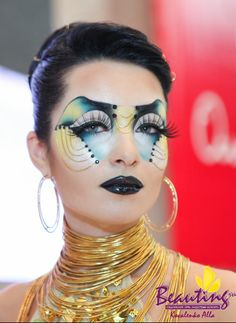 Crystals accent this colorful fantasy make-up with stunning eye lashes.