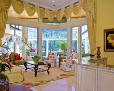 Traditional living room in a beautiful tropical setting. Ficarra Design.