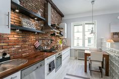 Rustic brick in kitchen wall