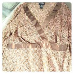 Sheer Lane Bryant top, perfect over tanks Lightweight and sheer, wear your favorite tank tops and still have some camouflage size 14/16, veins of pink, rose and gold make up the design. Lane Bryant Tops Blouses