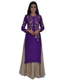 <p>Classic Chic, this new kurta tunic is adorned with exquisite hand embroidered gold gota patti and zari work on front and sleeves. The kurta has a round shaped neckline and 11 inches long front opening with hook closures. The front neck depth is 5