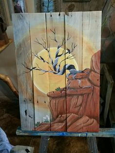 Dead cedar tree and raven in the sunset and red rocks art by Stacie Sheets