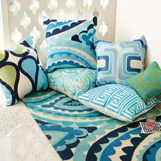 Trina Turk hook rug + embroidered pillows...