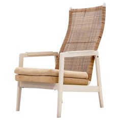 Mid-Century P.J. Muntendam Rattan Lounge Chair Dutch Design, 1950s | From a unique collection of antique and modern lounge chairs at https://www.1stdibs.com/furniture/seating/lounge-chairs/